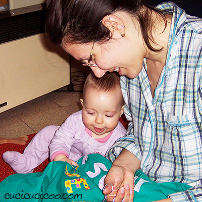 Learn about Cucicucicoo: Eco Sewing & Crafting and how it grew from the founder's love for doing it herself, eco-sustainability and using manual arts as a form of therapy. Mother sewing with baby daughter.