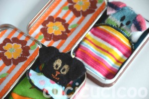 Little toy dogs made from felted wool sweaters in beds from Altoids tins | www.cucicucicoo.com