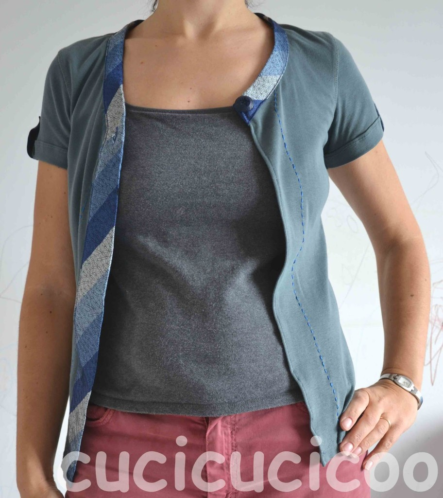 A funky twist on the classic t shirt-to-cardigan refashion: wrap a tie around the open edges and add a single funky button, and you have a unique garment!