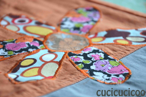 flower applique on ripped pants