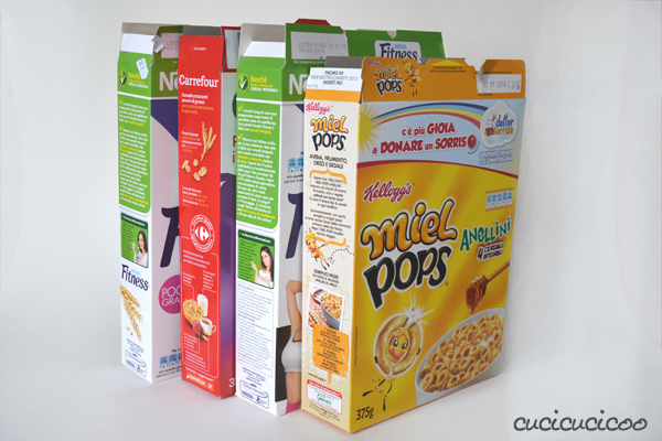 Don't use wasteful wrapping paper this year! These cereal box gift boxes are easy to make and are unique with produce net ties and bows! Cheap and ecofriendly! www.cucicucicoo.com