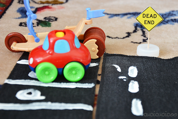 Three DIY street toys from repurposed materials for kids who love cars! Toy streets, street signs and a stoplight   www.cucicucicoo.com