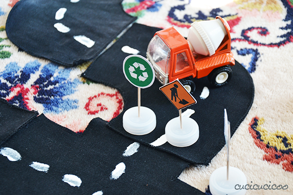 Three DIY street toys from repurposed materials for kids who love cars! Toy streets, street signs and a stoplight | www.cucicucicoo.com