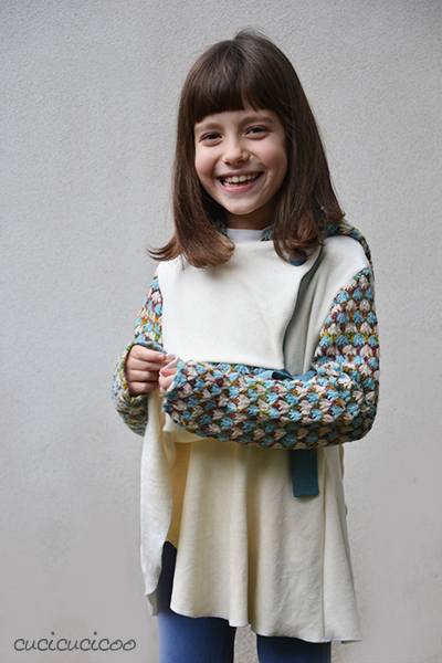 One Cardigan by Serger Pepper. A sweet and versatile crossover sweater with a tie and petal skirt. Options: pixie hood, regular hood, short/long/no sleeves, buttons. Pattern review by www.cucicucicoo.com