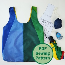 Free pattern: The Carry Everywhere Shopping Bag pattern! Upcycle an umbrella or use lightweight fabric to sew a shopper that can be stuffed in a hidden attached pouch! www.cucicucicoo.com