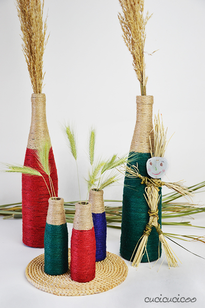 Upcycle your glass bottles to create cool home décor! These DIY wine bottle vases are easy to make with glue and twine and are a great house warming gift! #winebottlecrafts #winebottles