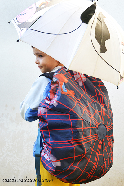 Upcycle umbrellas to protect your backpack during bad weather! These DIY backpack rain covers are quick and easy and perfect for kids and adults alike! www.cucicucicoo.com