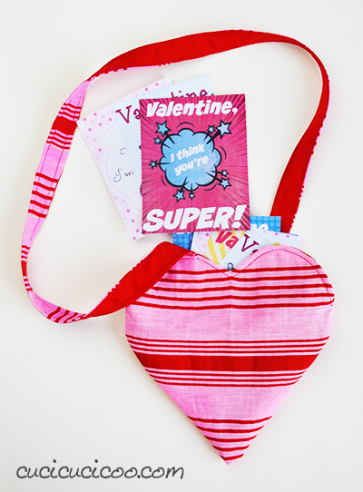 This reversible heart-shaped Valentine's Day bag is perfect for little girls to carry all their valentines, candy or other treasures in! FREE sewing pattern and tutorial by Cucicucicoo Patterns! #valentinesdaysewing #vdaysewing