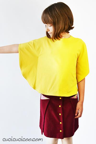 È difficile accontentare i ragazzi con l'abbigliamento. Il tour Growing Up Handmade mostra opzioni per cucire vestiti per adolescenti che gli piacciono e che vogliono indossare! La gonna Pocket Fold Skirt di Madeit Patterns e la Butterfly Sleeve Tunic, cucito da www.cucicucicoo.com