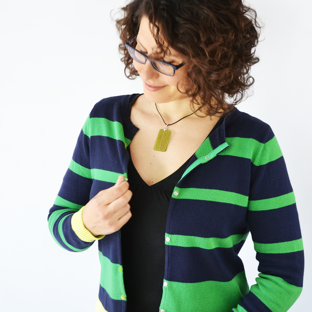 Cardigans are fantastic for layering clothing during in-between seasons. Learn how to refashion a sweater into a cardigan with one simple cut and two strips of fabric in just 10 minutes! Super easy!