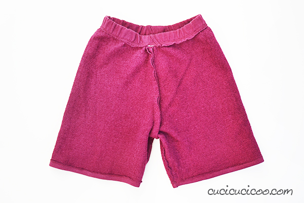 Kids grow out of their trousers and rip holes in the knees quickly. But don't throw those ruined clothes away! It's quick and easy to turn old pants into shorts with the help of the sewing machine free arm!