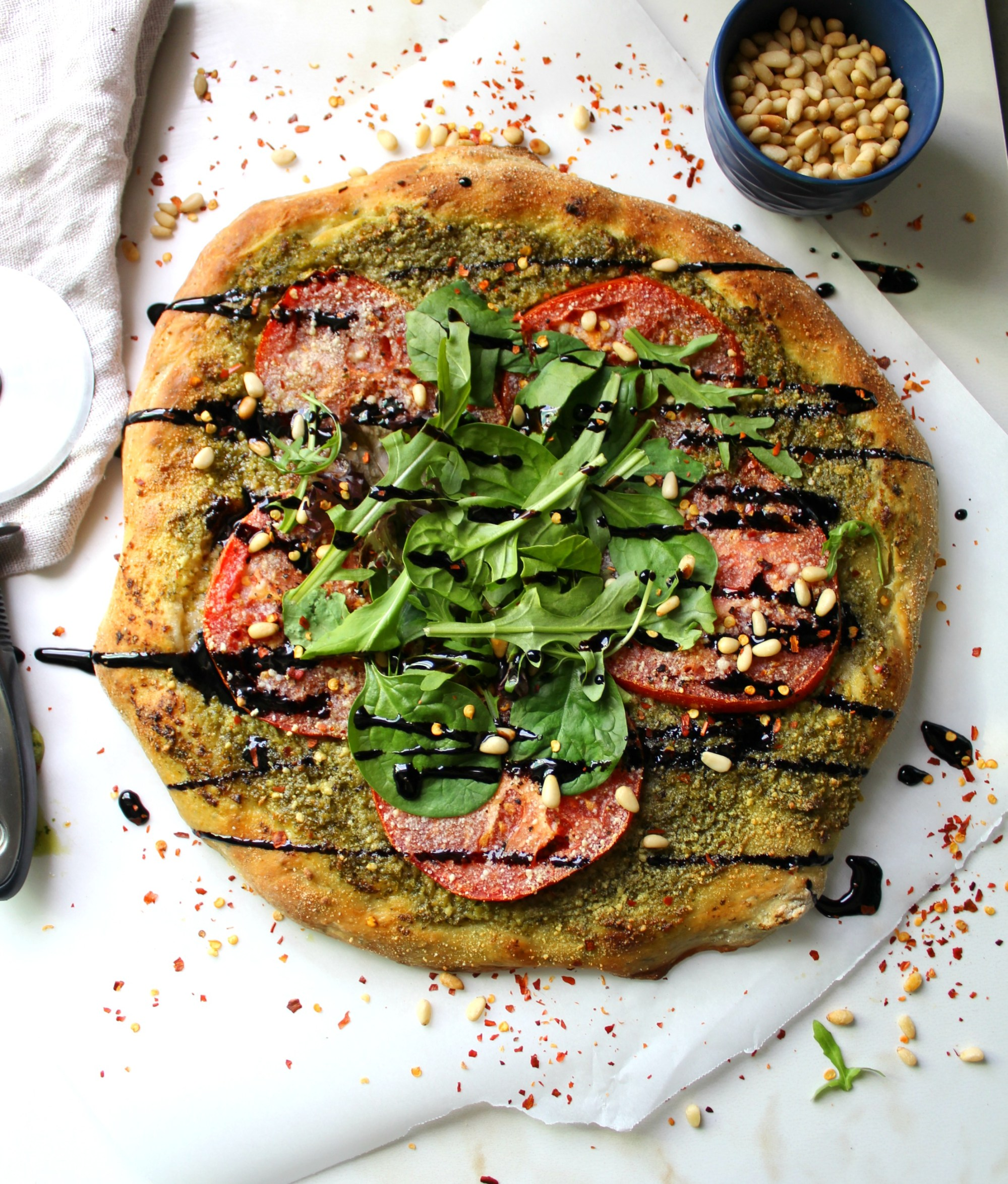 15 mouthwatering ways to use homemade basil pesto in your cooking: Vegan Pesto Pizza with Balsamic Glaze by This Savory Vegan