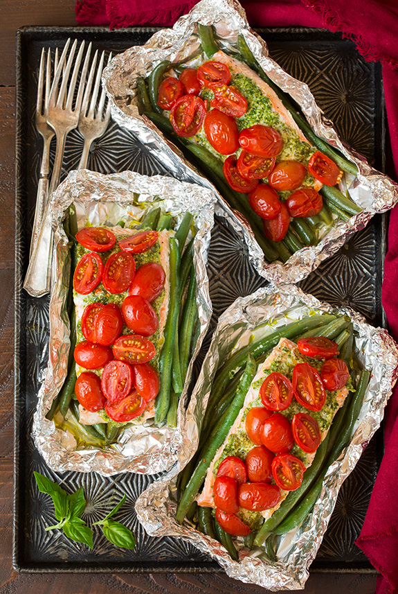 15 mouthwatering ways to use homemade basil pesto in your cooking: Pesto Salmon and Italian Veggies in Foil by Cooking Classy