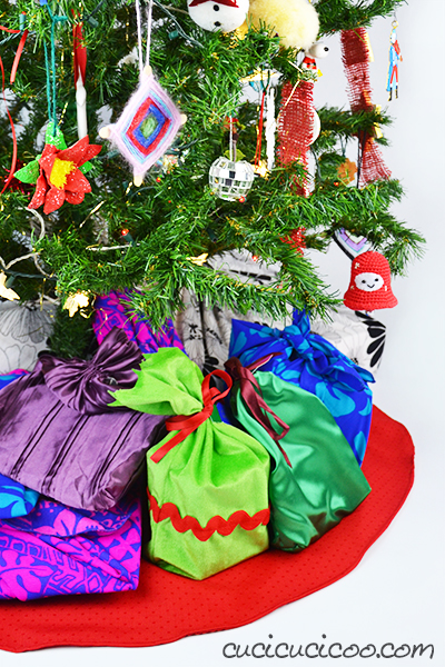 Reduce, reuse and recycle this holiday season and learn how to make a Christmas tree skirt from a tablecloth! A fast and easy sewing and upcycling tutorial! #diychristmas #christmastreeskirt