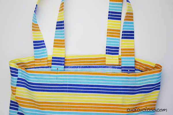 No more ripped plastic bags with the One Square Tote, an easy tote bag sewing tutorial made from a single square of fabric! Simple and eco-friendly! #reusableshoppingbag #totebag
