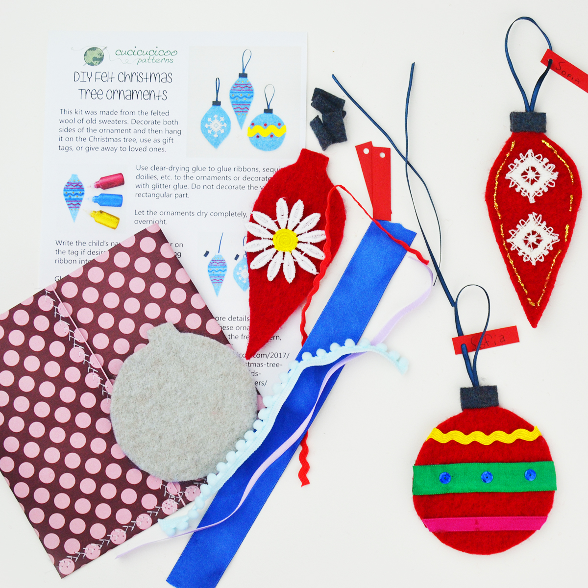 Looking for a fun and crafty gift for the kids in your life? These DIY Christmas ornament kits are easy to make with scraps of felt or felted wool sweaters and bits of ribbon. Package them up with the printable instruction sheet, and the children can make their own personalized baubles to hang on the tree! #diychristmas #diycraftkit #diycraftkits