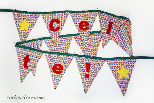 Impara come fare bandierine di stoffa con delle lettere e parole applicate per mettere gioia e festività alla stanza! Link ad un cartamodello con 5 forme e 4 misure! #festone #ghirlanda