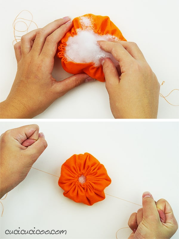 Stuffing and closing up the top of a simple DIY Jack O Lantern stuffed toy. A perfect Halloween craft project for kids! #halloweencraftforkids #halloweenkidcraft