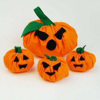 This easy Jack O Lantern softie tutorial is quick and easy to sew by hand, and a perfect Halloween craft project for kids who are just learning to sew! #halloweencraftforkids #halloweenkidcraft