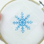 Learn how to embroider snowflakes in three simple ways with this free embroidery pattern. Embellish your winter and holiday decorations by hand! #winterembroidery #christmasembroidery