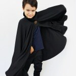 Learn how to make a vampire cape with a stand up collar! This easy cloak tutorial is made to size, so it's perfect for any age or any size. The rigid collar with a decorative button makes it look Dracula-authentic and the circle cape swirls around for super swingy fun! A perfect DIY costume for Halloween! #diycostume #halloweencostumetutorial #halloweencostumediy