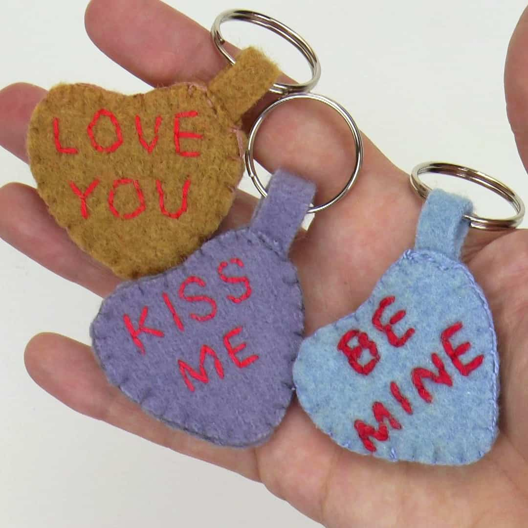 """This Valentine's Day keychain sewing tutorial will let you make a unique gift for your loved ones! Use upcycled fabric and simple embroidery for an eco-friendly present saying """"I love you!"""" #valentinesdaysewing #valentinesdaygift #sewingtutorial"""