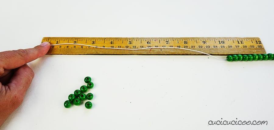 Lascia 25 cm di cordoncino elasticizzato (portatovaglioli con perline)