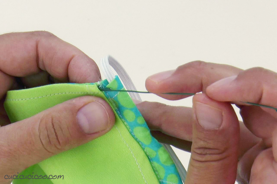 Inserting the removable nose wire into a premium fabric face mask.