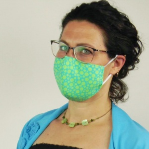 Free DIY contoured face mask pattern to sew your own premium and fashionable shaped surgical mask with adjustable elastic ear loops, optional straps, and a removable nose wire. The pattern includes 3 sizes and instructions on sewing a contoured filter to fit perfectly inside the filter pocket. #facemaskpattern #facemasktutorial #diyfacemask