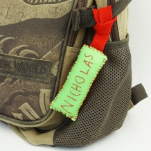 Teach your child to sew with this kid embroidery project. Use two basic hand stitches to sew a backpack tag with her name embroidered on it. Perfect for back to school! #kidsewing #kidssew