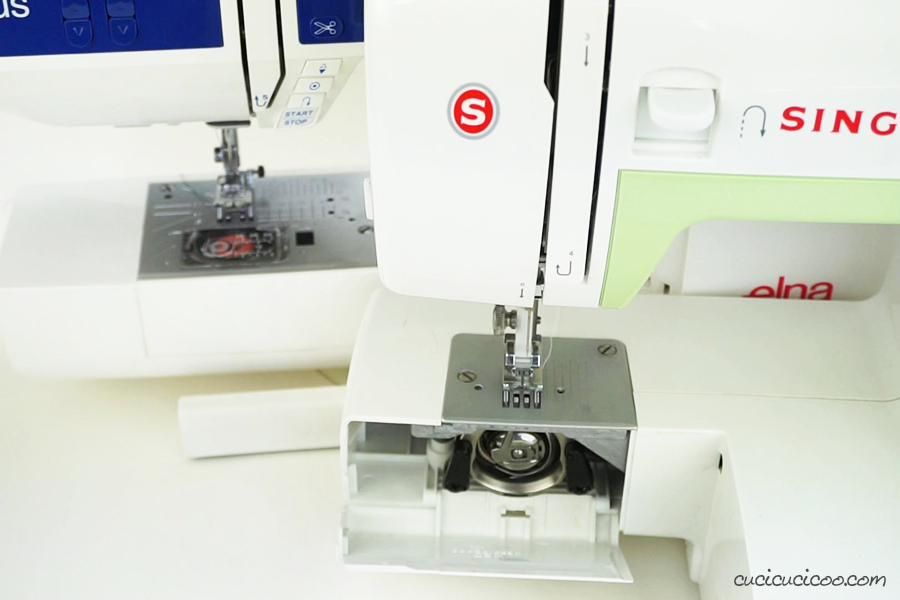 Two sewing machines with different bobbin loading