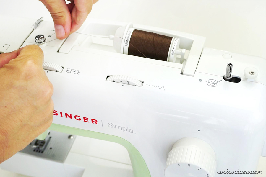 Learn how to wind a bobbin on a Singer Simple sewing machine, as well as an Elna Lotus. Video tutorial included! #sewing #bobbin