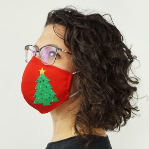 Enjoy the holidays while socially distancing with this DIY Christmas face mask! The adorable Christmas tree is easy to applique to the fabric and decorate with beads and sequins. The handmade face mask pattern is FREE, with three sizes and has options for a nose bridge, adjustable ear elastics and a removable tie. #facemaskpattern #christmasfacemask #christmassewing