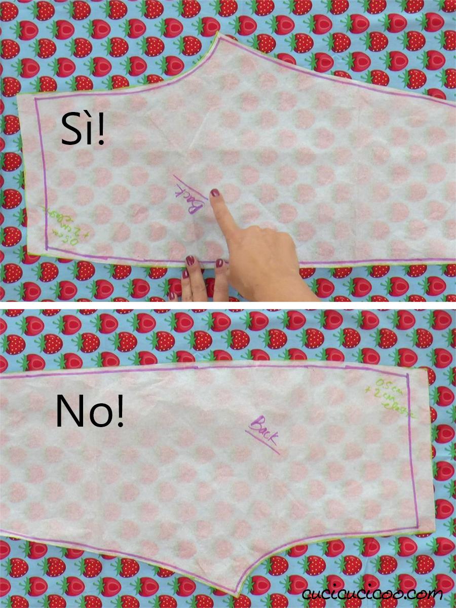 Posizionare il cartamodello sul tessuto con il motivo direzionale