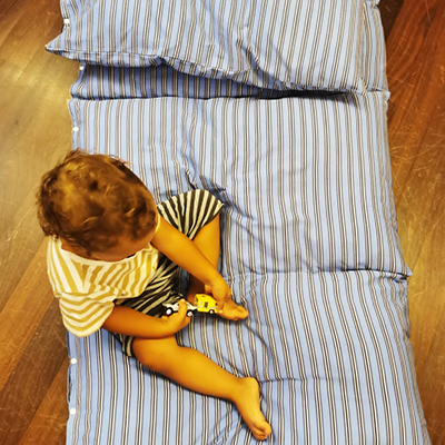 The easiest floor pillow bed DIY tutorial! Repurpose a sheet and stuff it with 4 standard bed pillows. A great easy sewing project for beginners! Awesome DIY gift for kids and adults!