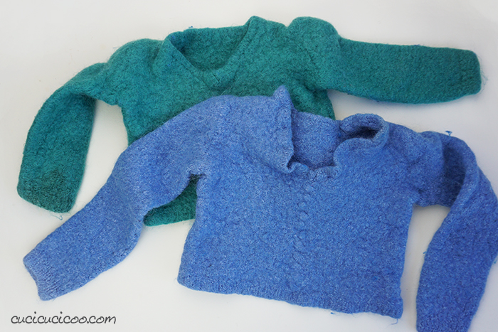 Machine felted wool sweaters before getting cut and sewn into a DIY felt banner bunting