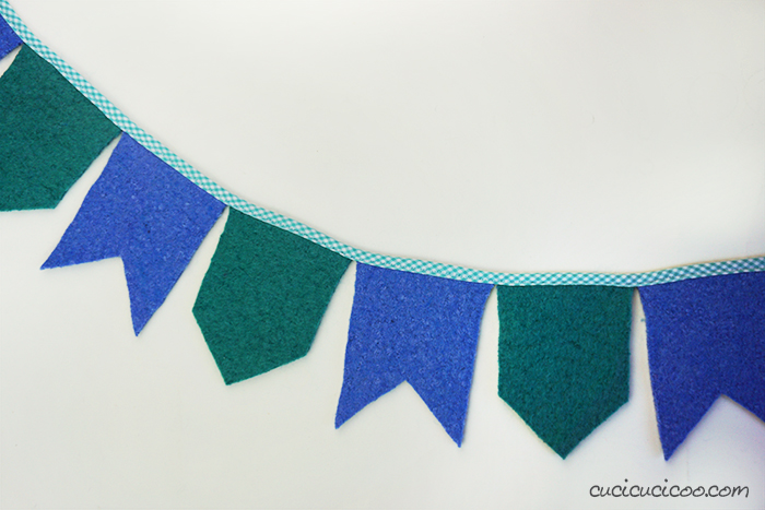 Accidentally felted a wool sweater in the washing? Cut it up and sew this felt bunting DIY! Such a fun and eco-friendly decoration, or use a loved one's clothing to remember her by.