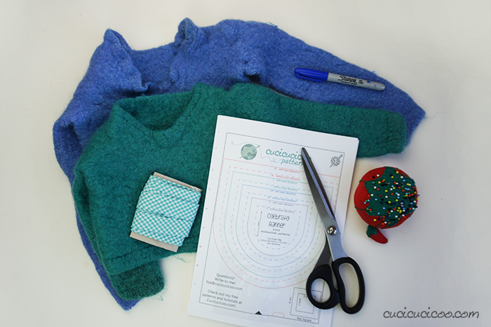 Materials for making wool felt bunting from old sweaters and bias tape