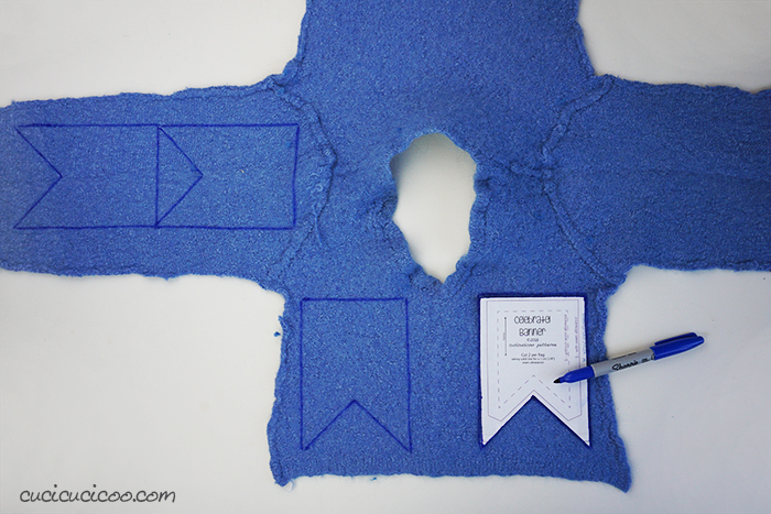 Cut out the bunting pieces from an old felted wool sweater